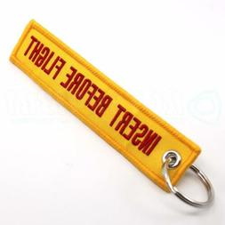 INSERT BEFORE FLIGHT QTY= 1 PC YELLOW/red KEYCHAIN RING TAGS